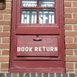 red door of library with book return door in lower panel