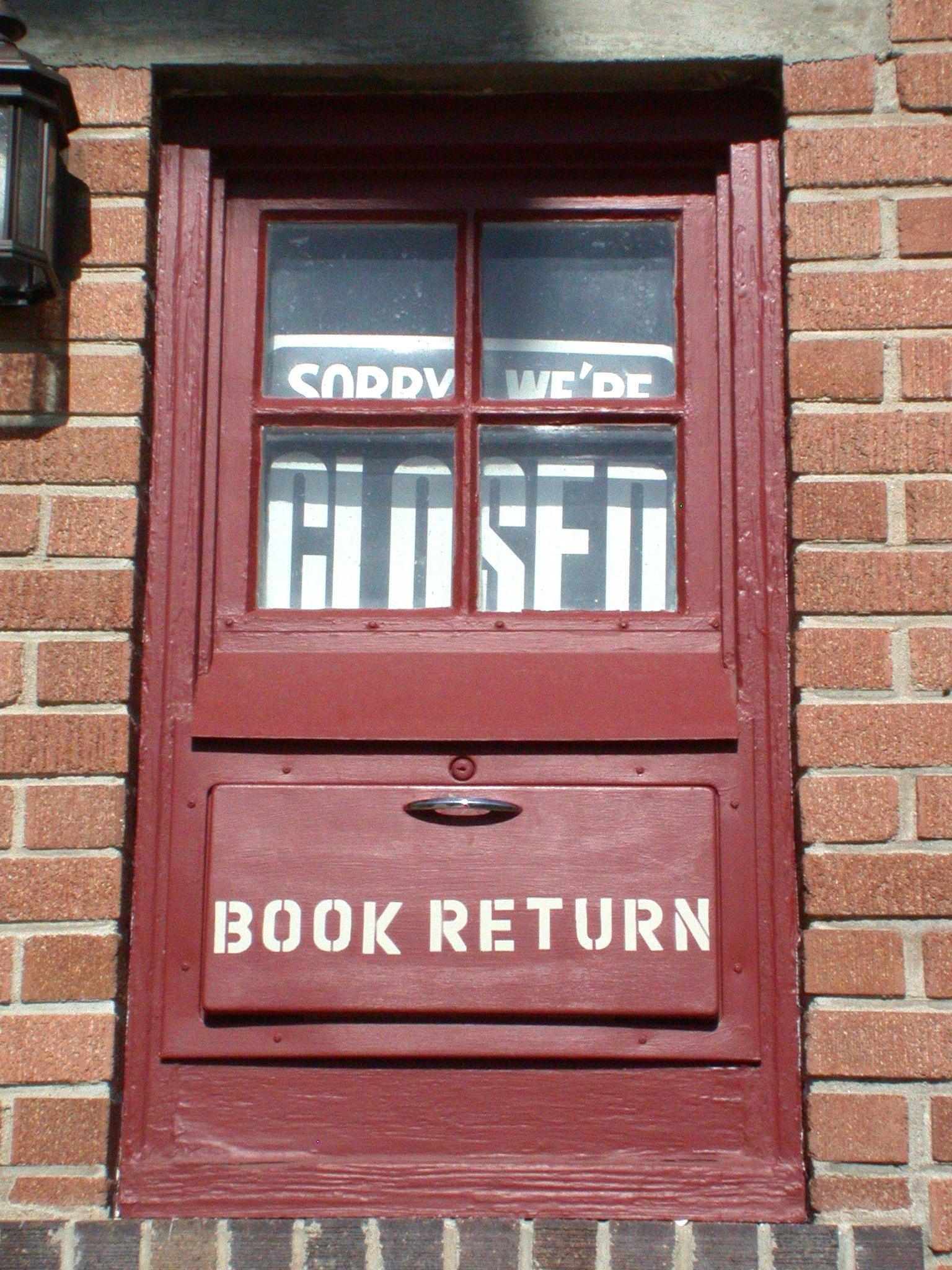 red door of library with book return door in lower panel